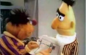 Ernie shows Bert his treasure map.