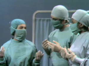 The doctors confer.