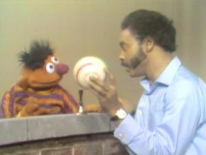 Gordon shows Ernie a ball.