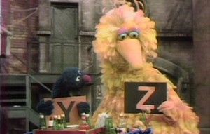 Grover and Big Bird demonstrate the end of the alphabet.