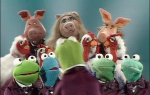 Kermit conducts the Muppet Glee Club.