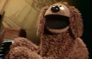 "Rowlf sings ""You and I and George""."