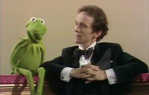 Kermit chats with Joel Grey.