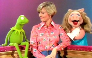 "Piggy catches Kermit and Florence ""in the act""."