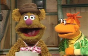 Fozzie tries out his latest joke on Scooter.