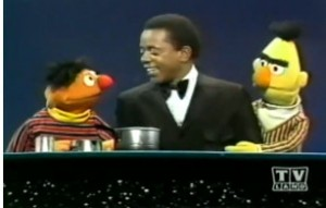 Flip greets Ernie and Bert.