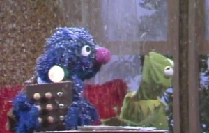 Grover makes it snow at Kermit's.