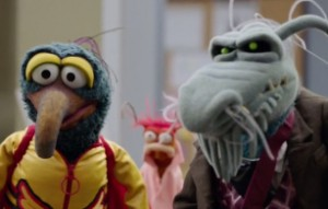 Gonzo and Uncle Deadly listen to Kermit.