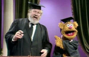 Peter Ustinov and Fozzie crack jokes.
