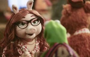 Denise bids Kermit adieu.